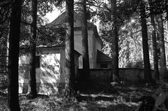Old church with a cemetery. Alone in the forest, the village disappeared L.P. 1600 Royalty Free Stock Photos