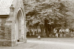 Old church and cemetery in sepia tone. Church and grave markers in Southern Cemetery Royalty Free Stock Photos