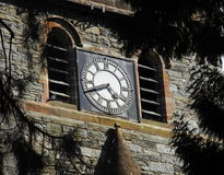 Old church clock, in stonework Royalty Free Stock Image