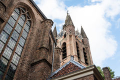 Old church of Delft. Low angle view of Tower clock Royalty Free Stock Images