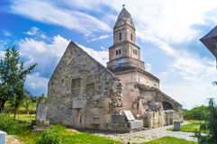 Old church of Densus. The Densuș Church (also known as St Nicholas' Church) in the village of Densuș, Hunedoara County, Romania is one of the oldest Romanian Stock Photo