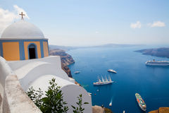 Old church dome and view of boats in Santorini Stock Image
