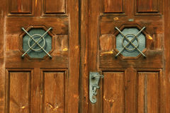 Old church door. Detail of an old wooden church door royalty free stock images