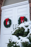 Old Church Door with Christmas Wreaths royalty free stock images
