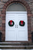 Old Church Door with Christmas Wreaths royalty free stock image