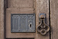 Old church door with handle and lock. Detail of old wooden church door with handle and lock Royalty Free Stock Image