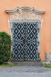 Old church door. Metal side door of the church in Central Bohemia Royalty Free Stock Photo