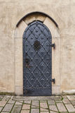 Old church door. Metal side door of the church in Central Bohemia Royalty Free Stock Images