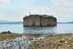 Old church engulfed in the water of dam lake. Silhouette of flooded small Orthodox church in the waters of large lake, Zhrebchevo dam was built during the Soviet Stock Image