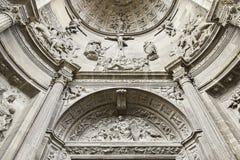 Old church facade. Detail of an arc of a church, religious art Stock Photo