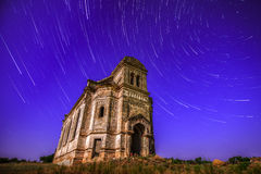 The old church flying in star trails Stock Photo