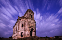 The old church flying in stormy clouds Royalty Free Stock Image