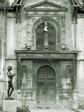 Old church front door. Statue of a girl playing banjo in front of the church royalty free stock photo