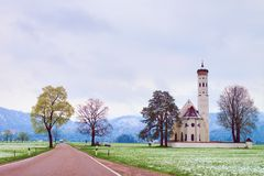 Old church and graveyard.  Straight  way at meadows. April weather. Royalty Free Stock Photography
