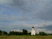 Old Church in a green field Royalty Free Stock Photo