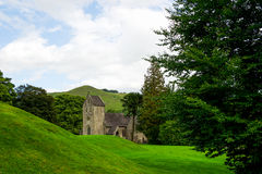 Old Church, Green Meadows and Trees in Beautiful Ilam Hall Royalty Free Stock Images
