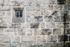 Old church stone wall with small window texture background Stock Photography