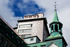 Old Church and Hospital. Old Church Overshadowed by a Hospital in Quebec Stock Image