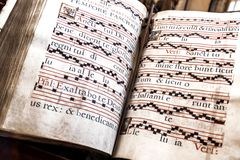 Old church hymnal-book. Closeup of an old hymnal-book with Latin text Stock Photography