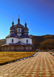 The old church.jpg. An ancient Christian church in the background of low hills, blue sky Royalty Free Stock Photography