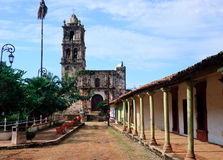 Old church in Kopala in Mexico. Ancient church in town square of Kopala with covered walkway to entrance royalty free stock images