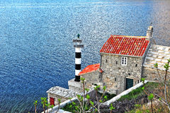 Old church and lighthouse in Montenegro Royalty Free Stock Photo