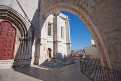 Old church in Lisbon. Arch over the aisle. Exit to the observation deck. Bright sunlight Stock Photo