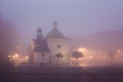 Old church on the market square in Krakow at Stock Photography