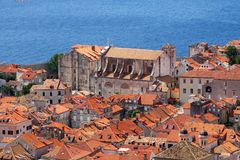 Old church near sea in Dubrovnik stronghold. Nice view over a small area of Dubrovnik old town from Croatia. Thea sea is near a big church, surrounded by a lot stock photo
