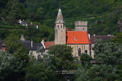 Old church nearby the danube river stock photography