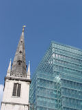 Old church and new building. View of old church tower and new office building in City of London royalty free stock photo