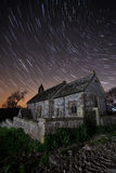 Old church at night with star trails Stock Photo