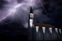 Old church at night during a thunderstorm, thunderbold hitting tower Royalty Free Stock Photo