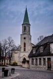 Old church at old historic town. Of Kuldiga, Latvia. Shot at dusk. Dark blue skies, nice buildings, no people stock photo