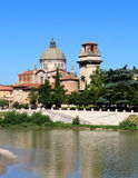 Old church over river Adige Royalty Free Stock Images