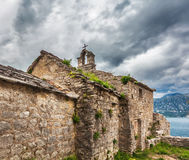 The old church overlooking the sea in bad weather Stock Photo