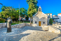 Old church in Primosten, Croatia. Scenic architectural view at small chapel in center of tourist resort Primosten, Croatia Stock Image