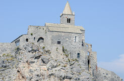 Old church on a rocky coastal outcrop at Portovenere Stock Image