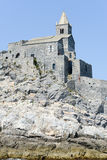 Old church on a rocky coastal outcrop at Portovenere Royalty Free Stock Image