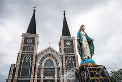 Old church of Roman Catholic Christianity and Virgin mary statue Royalty Free Stock Image