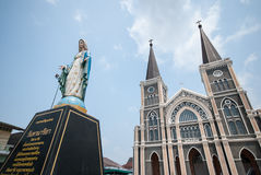 Old church of Roman Catholic Christianity and Virgin mary statue Stock Image
