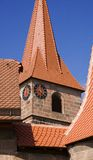 Old church roof. Roof of old church in small German village. Focus on clock. Canon 5D, 100-400, raw Royalty Free Stock Image