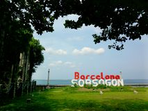 Old church ruins and the Barcelona, Sorsogon sign. Photo of an Old church ruins and the Barcelona, Sorsogon sign in the Bicol region of the Philippines in Asia Stock Image