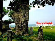 Old church ruins and the Barcelona, Sorsogon sign. Photo of an Old church ruins and the Barcelona, Sorsogon sign in the Bicol region of the Philippines in Asia Stock Photography