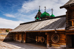 Old church in Russian village. Russian old wooden house and a church Stock Images