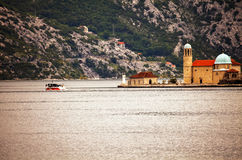 The old church in the sea in bad weather Stock Images