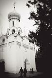 Old church seen thgrough tree trunks. Royalty Free Stock Image