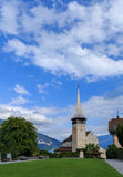 Old church, Spiez. Beautiful park, old church blue summer sky and lake view. City of Spiez, canton Bern, Switzerland Royalty Free Stock Photo