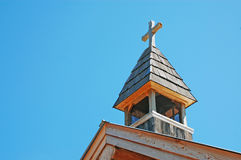 Old church steeple. Old wooden church steeple against blue sky Royalty Free Stock Photo