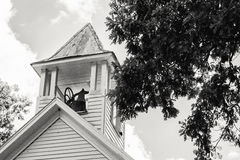 Old Church Steeple with Bell. Black and White picture of old church steeple with a bell Stock Photo